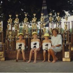 Rose poses with the boys and some of their hardware. (From left, Nicky, Tommy, and Roger.) - Photo: Hayden Family Collection