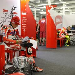 Going over the numbers in the cavernous Silverstone garage. - Photo: Milagro/Ducati